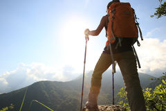 Backpacker enjoy the view on mountain peak Royalty Free Stock Images