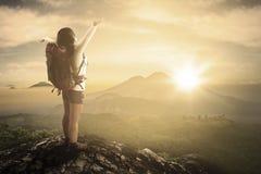 Backpacker enjoying freedom on mountain Royalty Free Stock Images