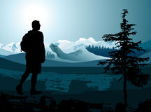 Backpacker enjoying of a mountain Stock Images