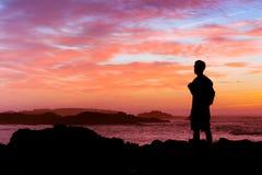 Backpacker. Enjoying sunset at atlantic ocean coast Stock Images