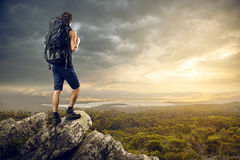 Backpacker. Enjoys a nice view Stock Photos