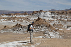 Backpacker exploring the Moon Valley in Atacama Desert, Chile Stock Photo