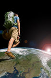 Backpacker Exploring The World. A backpacker exploring the world. Image of Earth from NASA public domain catalog Stock Image