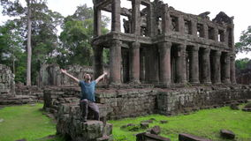 Backpacker feeling freedom in preah khan temple, angkor, cambodia Stock Images