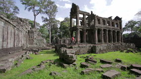Backpacker feeling freedom in preah khan temple, angkor, cambodia Stock Photos