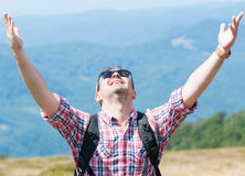 Backpacker feeling happy and victorious on the mountain Stock Photography