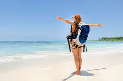 Backpacker feeling the wind. Backpacker girl feeling the wind on the beach Stock Photo