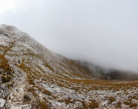 Backpacker fog mountain slope panorama Stock Images