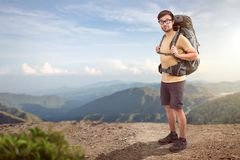 Backpacker in front of a tropical mountain view Royalty Free Stock Image
