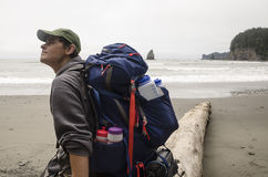 Backpacker Gazing Up at the Beach Royalty Free Stock Photography