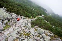 Backpacker girl. Backpacker girl tourist exploring the Tatra mountains national park, Poland Royalty Free Stock Image