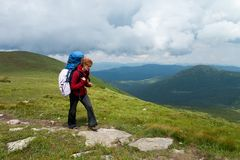 Backpacker girl in the mountains Royalty Free Stock Photography