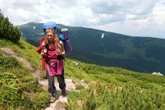 Backpacker girl in red dress Royalty Free Stock Images