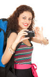 Backpacker girl taking picture Stock Images