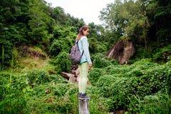 Backpacker girl travel in tropics Stock Image
