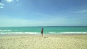 Backpacker Girl Walking On The Beach stock video