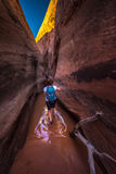 Backpacker Girl in the water Zebra Slot Canyon Escalante Utah Stock Images