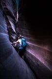 Backpacker Girl in Zebra Slot Canyon Stock Photos