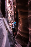 Backpacker Girl in Zebra Slot Canyon Escalante Royalty Free Stock Image