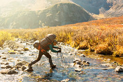 Backpacker go across the river Royalty Free Stock Image