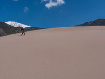 Backpacker at Great Sand Dunes National Park Royalty Free Stock Images