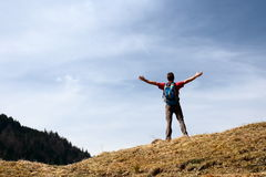Backpacker with hands up Royalty Free Stock Photos