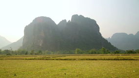 Backpacker heaven,Vang Vieng with limestone mountains,Laos. Day time stock video footage