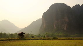 Backpacker heaven,Vang Vieng with limestone mountains,Laos. Day time stock footage