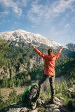 Female hiker celebrating view of Tahtali in Turkey. Backpacker with her hands raised standing next to her backpack celebrating view of Tahtali on a sunny day Stock Photos
