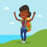 Backpacker with her hands up enjoying the scenery. Royalty Free Stock Photography