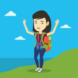 Backpacker with her hands up enjoying the scenery. Stock Photography