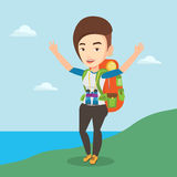 Backpacker with her hands up enjoying the scenery. Royalty Free Stock Image