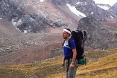Backpacker in high mountain Stock Photos