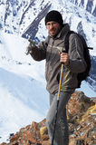 Backpacker in high mountain Royalty Free Stock Image