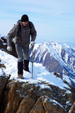 Backpacker in high mountain Stock Image
