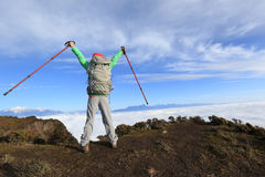 Backpacker hiker open arms at beautiful mountain peak Stock Photography