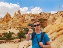 Backpacker hiking along Cappadocian rocky valley Stock Photography