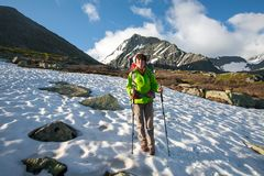 Backpacker is hiking in highlands of Altai mountains, Russia.  Stock Images