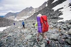 Backpacker is hiking in highlands of Altai mountains, Russia.  royalty free stock images