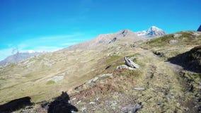 Backpacker hiking in idyllic landscape. stock footage