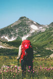 Backpacker hiking at mountains. Travel Lifestyle adventure wanderlust concept summer vacations outdoor Royalty Free Stock Photo