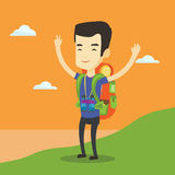 Backpacker with his hands up enjoying the scenery. Royalty Free Stock Images