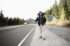 Backpacker hitchhiking Royalty Free Stock Photo