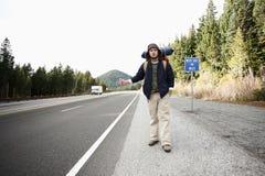 Backpacker hitchhiking Royalty Free Stock Photo