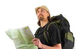 Backpacker holding a map ang looking up Stock Photography