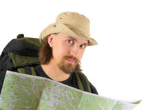 Backpacker holding a map Royalty Free Stock Image