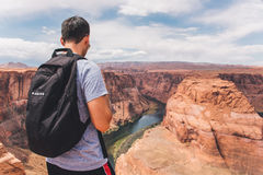 Backpacker on horseshoe bend Stock Photos