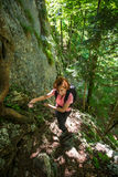 Backpacker lady on forest trail Royalty Free Stock Images