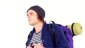 Backpacker looking through his binoculars stock video footage