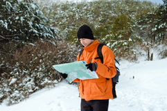 Backpacker looking at map Stock Image